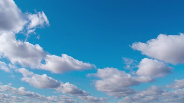 Thumbnail for Cirrus Clouds in a Clear Blue Sky. White Clouds Move Across the Sky in Spring.