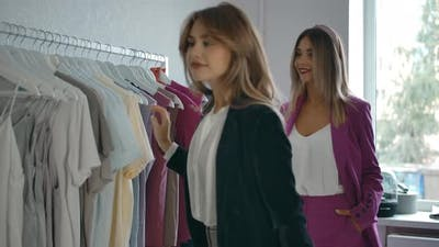 Woman Helping Friend to Choose Clothes