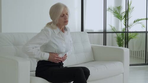An Elderly Woman Suffers From Abdominal Pain a Mature Elderly Adult Woman Feels Abdominal Pain While