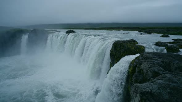 Thumbnail for Epic and Scenic Iceland Waterfall at Midnight Sun