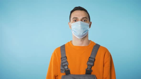 Thumbnail for Builder Portrait with Face Mask Covid 19 Restrictions in Blue Background