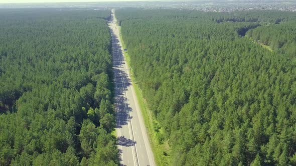 Thumbnail for Aerial: Flying Back Over the Highway, Located in Dense Forest