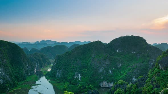 Cover Image for Sunset time lapse aerial view of Ninh Binh region, Trang An Tam Coc tourist attraction Vietnam