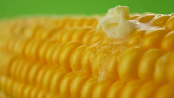 Piece of Butter Melts on Hot Corn