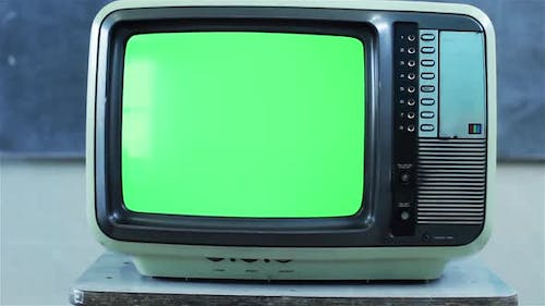 Old TV with Green Screen in a Classroom. Aesthetics of the 80s.