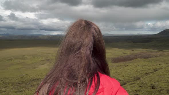 Cover Image for A Girl Looks at the Beautiful Landscape of Iceland.