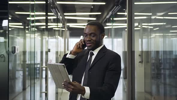 Thumbnail for Businessman which Talking on Phone with Business Partner and Discussing Details