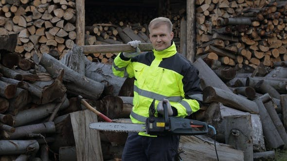 Thumbnail for Lumberjack Worker. Man Woodcutter Holds Big Axe and Electric Chainsaw on His Hands