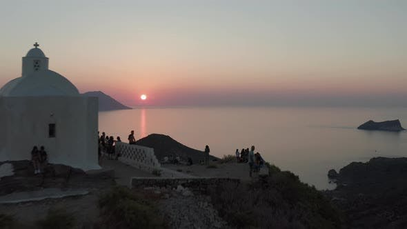 Thumbnail for People Tourists Enjoying the Sunset From Church Viewing Point Over Island in Greece