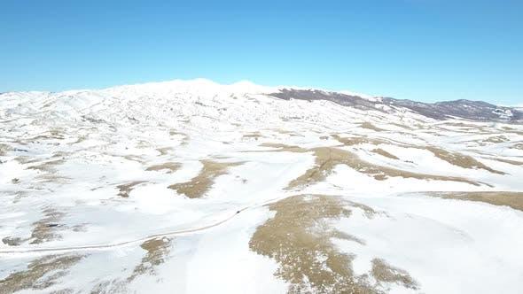Thumbnail for Car Passes Through Snowy Mountains
