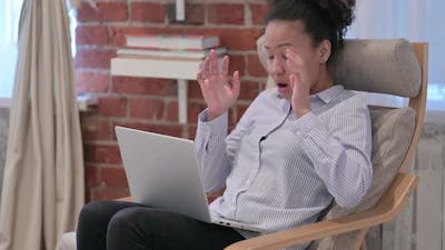 African American Woman with Laptop Having Headache