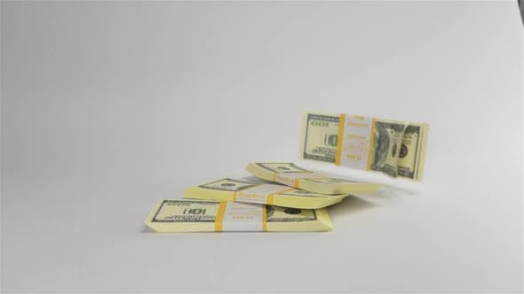 Thumbnail for Bundles of Dollars Falling on White Surface