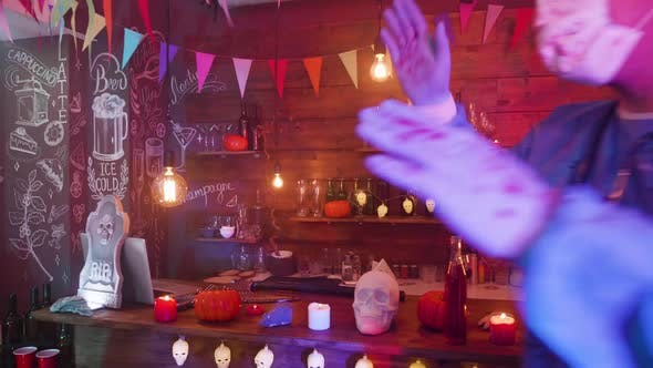Thumbnail for A Bar Decorated for Halloween and Young People in Scary Outfits Are Dancing