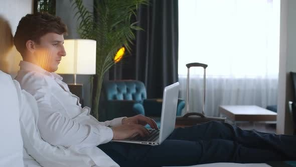 Thumbnail for Entrepreneur Using Smartphone and Laptop in Hotel