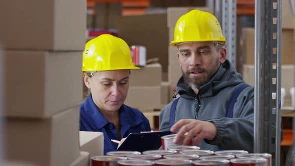 Thumbnail for Warehouse Workers Stock-Taking Cans of Paint