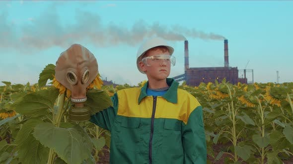 Thumbnail for Child in Protective Mask with the Plant Sunflower on the Background Industrial Plant. Environmental