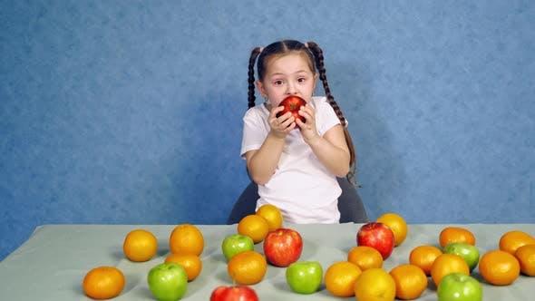 Thumbnail for Pretty little girl eating tasty apple