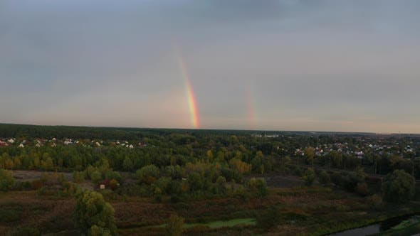 Thumbnail for Rainbow Over the Forest at Sunset. Aerial View