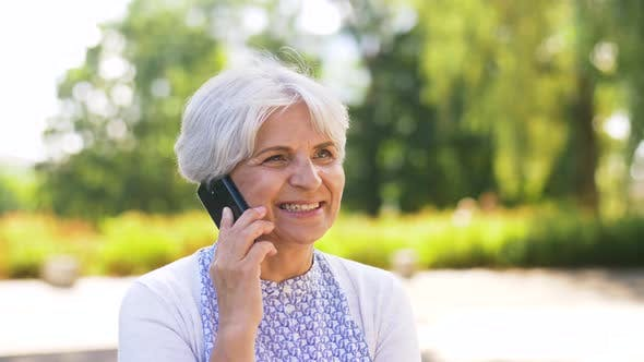 Thumbnail for Senior Woman Calling on Smartphone in Park