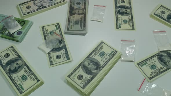 Thumbnail for Money And Drugs On The Table