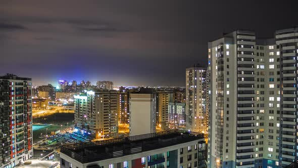 residential buildings at night. timelapse of the night city. living quarters, apartments