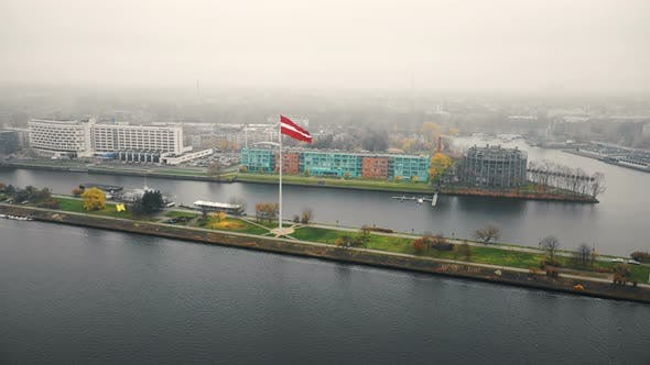 Thumbnail for Beautiful Aerial Cityscape View, Giant Flag of Latvia Waving Above the River Daugava and Buildings