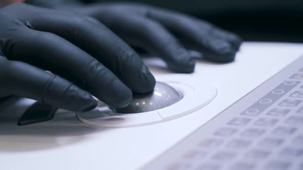 Thumbnail for a Scientist Works with Latex Gloves