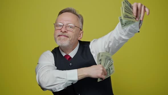 Thumbnail for Happy elderly man with money in his hands