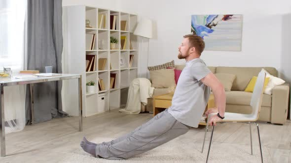 Thumbnail for Man Doing Chair Dips at Home
