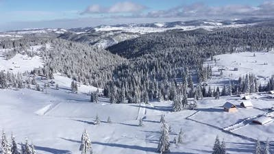 Flying Above Winter Mountain Scenery