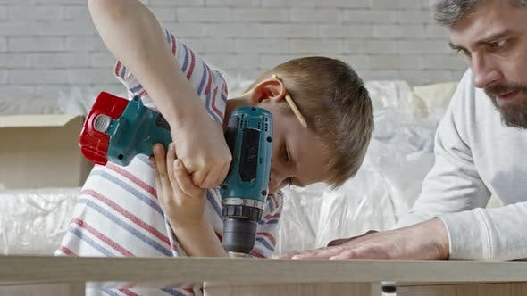 Thumbnail for Boy Learning to Use Electric Screwdriver
