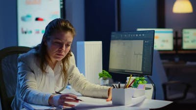 Overworked Woman Architect Analysing and Matching Blueprints