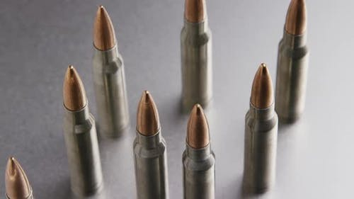 Cinematic rotating shot of bullets on a metallic surface - BULLETS 002