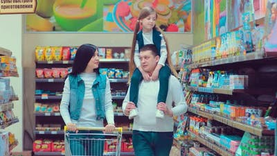 Happy Family Grocery Shopping Together