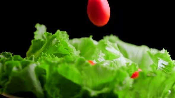 Thumbnail for Cherry tomatoes falling on lettuce leaves