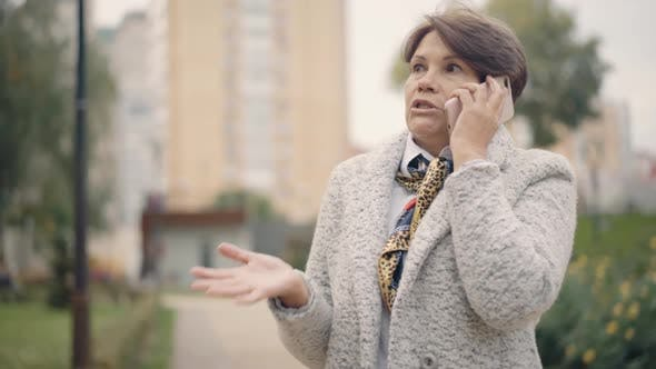 Thumbnail for Beautiful Senior Woman Talking on the Phone Outdoors
