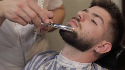 Client with Black Beard During Beard Shaving in Barber Shop. Groom, Masculine