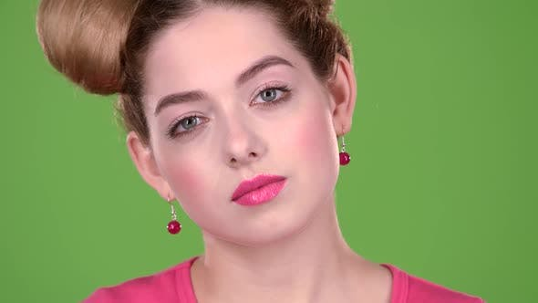 Thumbnail for Girl Begins To Smile at the Camera. Green Screen. Close Up. Slow Motion