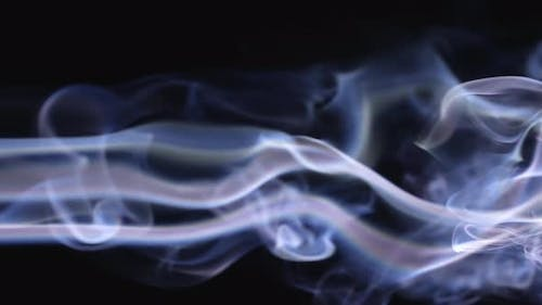 Smoke Streams From Left to Right in Intricate Patterns