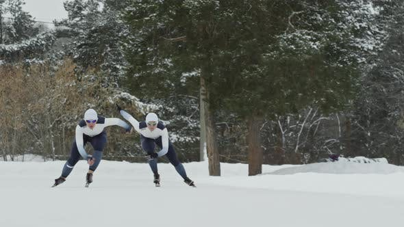 Thumbnail for Speed Skaters Training in Outdoor Ice Rink