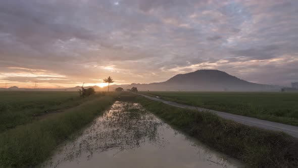 Timelapse gold sunrise which sunlight break through the thick cloud