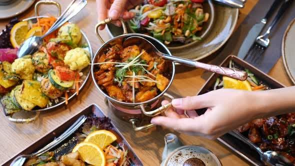 Thumbnail for Serving Vegan Asian Cuisine Dishes On Table