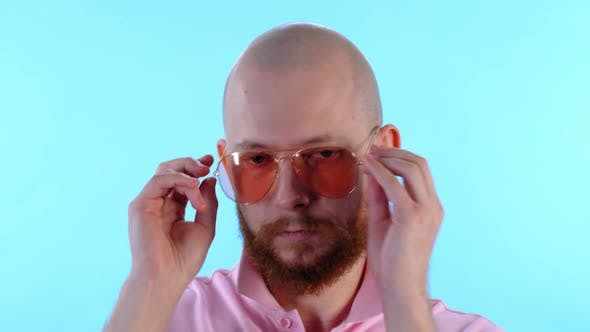 Thumbnail for Bearded Man Putting On Sunglasses