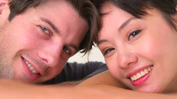 Thumbnail for Happy chinese woman smiling with boyfriend