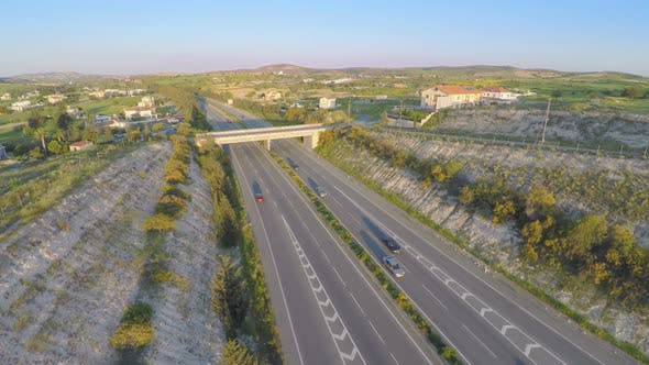 Aerial Shot of Active Traffic on Modern Freeway. Beautiful Landscape, Horizon