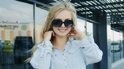 Woman in Sunglasses Posing