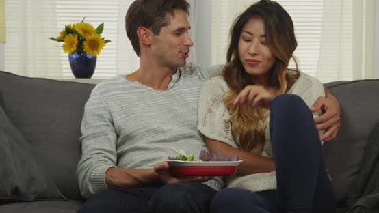 Thumbnail for Interracial couple eating chips and dip