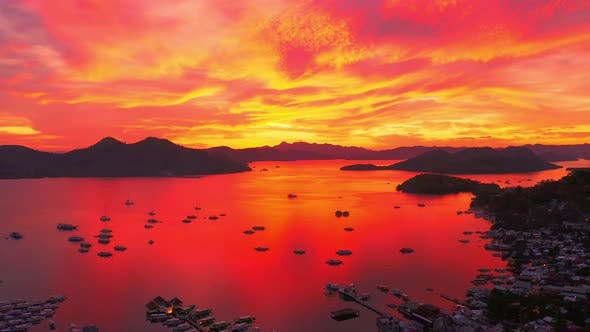 Cover Image for Red Sunset in the Sea Harbor with Moored Yachts