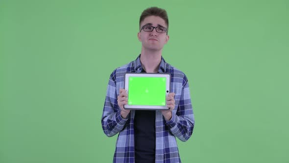 Thumbnail for Happy Young Hipster Man Thinking While Showing Digital Tablet
