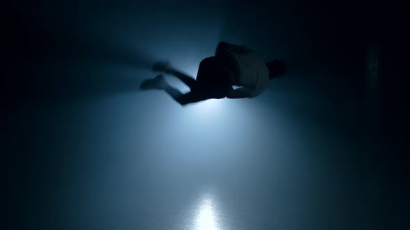 Thumbnail for Young Man Practicing Parkour in Smoke Dark Studio. Silhouette of Urban Runner
